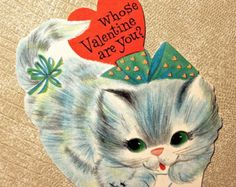 I just love sewing up cute Valentines for Valentines Day!!  This is a cute little black kitty Valentine framed in sweet fabrics with hearts and roses~ I added a strip of vintage lace, a pink ribbon rose, and a heart button. Hang from the soft red velvety trim hanger!  Sewn into a heart shape and stuffed plump into a pillow with high quality fiber fill then carefully hand sewn closed. Backing is a pastel pink and white striped cotton.  What cat lover wouldnt love to have this adorable…