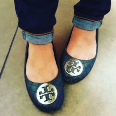 a gorgeous pair of quilted Tory Burch black Reva flats, with the exterior still in perfect condition.