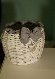 Decorative paper basket with a ribbon