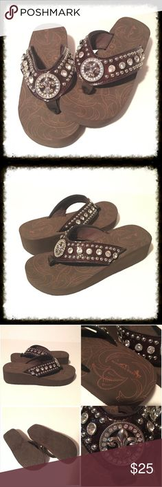 "Fleur de Lis Flip Flops Western Fleur-de-Lis style flip flops by Montana West. If you love Volatile flip flops, you will also love the comfort and style of these. Very comfortable mushy sole; 1.75"" poly-urethane EVA sole. Sole features a design pattern. Straps are padded to protect and comfort the feet. Beautiful rhinestone design. In excellent condition. Wedge measures 1.75"". True to size. *15% off bundles  *No trades *Reasonable offers are always considered *Happy poshing 🙂 Montana West…"
