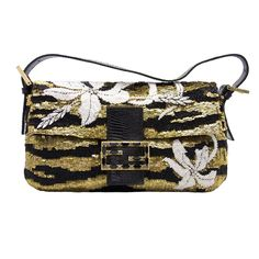 880.00 Fendi small Baguette bag featuring black and gold sequins white beaded flowers and crystal embellishments. The bag is fastened with a lizard skin strap with snap-shut closure