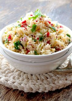 Lemon Rice Salad can be converted from a side salad to an easy dinner by simply adding cooked chicken to this already delicious dish.