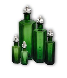 The Ascent of Man Vintage Green Poison Bottles with Silver Skull Bottle Stoppers ~ by Theo Fennell