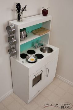 DIY play kitchen - I like the shelves...still storage for toys but takes up less floor space