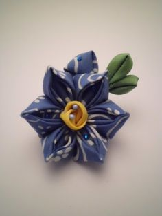 A hair clip and also a brooch. This is a blue and yellow narcissus. Made of hand-dyed batik cotton and with the method of making tsumami kanzashi. Listed on Etsy, $25.00