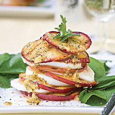 GRILLED PEACH & MOZZARELLA SALAD:  A cumin-lime vinaigrette spiked with a tiny amount of tequila adds a little something extra to this gorgeous grilled salad of peaches and fresh mozzarella cheese