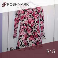 Floral dress This dress is in great conditions.  The base color is black with roses of pink, red, and white colors.  It is a long, sleeve dress,  nice for cooler temps.  ! Forever 21 Dresses