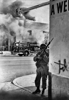 A national guardsman stands watch to help ward off snipers as firemen battle a blaze at furniture store in Watts, August Photo credit: Los Angeles Times Snipers, Firemen, August 15, New Chapter, Photo Credit, Battle, California, Times, Watch