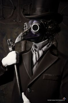"""Steampunk Plague Doctor. *plague doctors would stuff sweet smelling herbs into the """"beak"""" to mask the scent of decay.*"""