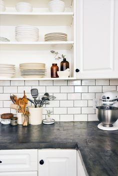 Subway tile w/ black grout, white cupboard, open shelving, darker countertop   Before & After: A Reclaimed Traditional Brick Foreclosure, on Design*Sponge