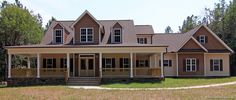 Low Country Farmhouse is a Farmhouse Style House Plan with a wraparound porch, open floorplan and a Master Suite on the main level.