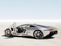 Jaguar C-X75 Going To Production It could body-double as a Lotus and appears to have the snout of an Aston Martin, but this new two-door coupe is a Jaguar. Another surprise, the C-X75 supercar is electric powered by Lithium-Ion batteries and two ultra-efficient electric motors. It'll go 560 miles on a full charge, but not if you keep it pinned at its top speed of 205 mph.