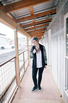 Pair a white button down shirt with a geometric cardigan or aztec cardigan, jeans, sneakers and a statement necklace for an easy, pulled together look. Click for details and three other ways to style a button down shirt.