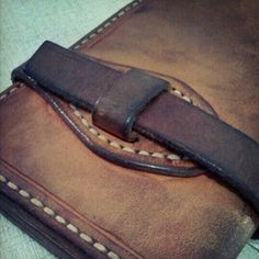 Leather -- loop and strap closure with reinforced base plate