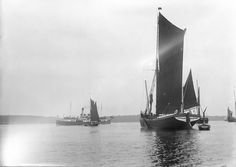 A view across the River Orwell from near Pin Mill with the spritsail barge 'Freston Tower' (1889) in the foreground. - National Maritime Mus...