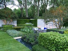 Deze geometrisch ingedeelde tuin is geïnspireerd op De Stijl, een beweging in…