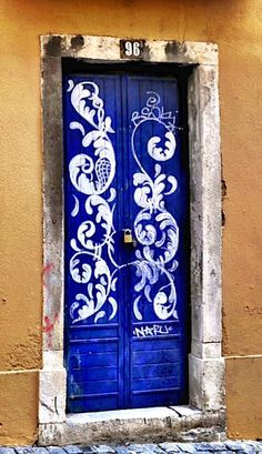 Lisbon, Portugal - I love that this door is painted with blue and white like the tile they are famous for in Portugal.