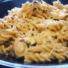 Crockpot Italian Chicken 4 Chicken Breasts (thawed) 1 packet Zesty Italian Dressing Seasoning 1 8oz package of Cream Cheese 2 cans Cream of Chicken Soup 1/4 - 1/2 can of Milk Instructions ( Edit ) Mix altogether in crockpot; cook on low for 4 hours. If sauce is too thick add a little milk. Serve over pasta or rice.