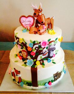 Deer and forest animal baby shower cake