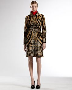Double Breasted Coat, Plisse Top, Plisse Top & D-Ring Mini Skirt  by Gucci at Neiman Marcus.