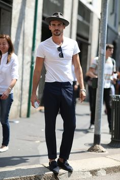 Simple street style - white tee, navy slacks, pants, trousers, grey fedora hat, and loafers...bottle of water and NO cell phone, yes.