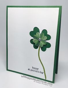 Create a 4-leaf clover with the negative space from a carefully placed heart punch.  With green paper behind it it, it makes the perfect handmade St. Patrick's day card.  Layer smaller hearts on top for interest and dimension.