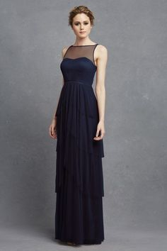Tiered Bridesmaid Dress: This navy blue bridesmaid dress was made for more formal weddings, and the layered tiers and illusion neckline give it a fashion-forward edge. It would look great with gold or champagne accessories.