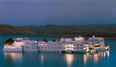 While traveling around India with Smithsonian Journeys, stay at the beautiful Taj Lake Palace Hotel. Most Romantic Places, Beautiful Places, Audley Travel, Travel Tours, Travel List, India Tour, Palace Hotel, Honeymoon Destinations, India Travel