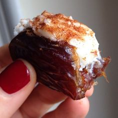 Better than a candy bar!  Medjool date stuffed with coconut butter then topped with cinnamon & sea salt.