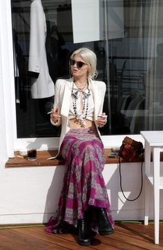 Unknown source. Tribal maxi skirt with crop top and blazer.