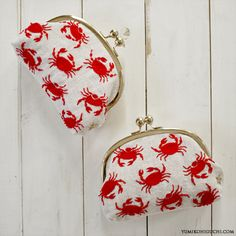 red crabs embroidery coin purse, By yumikohiguchi.