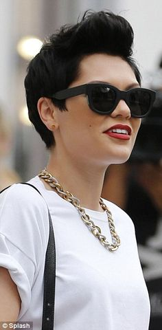 Jessie J - A strong mixed metal necklace, red lips, quaffed hair & dark shaded create drama