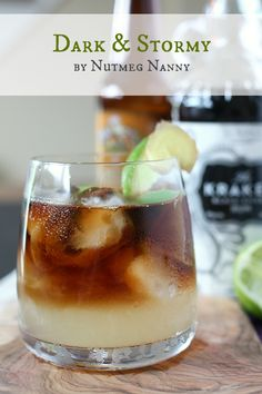 """Dark and Stormy by Nutmeg Nanny Ingredients: 3 parts spicy ginger beer 1 lime wedge 3 dashes lime bitters 3 parts black rum Directions: Fill a short cocktail glass with ice. Add in bitters, squeeze of lime and ginger beer. Slowly pour rum on top to create a """"stormy"""" look. Stir to combine."""