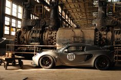 Lotus in an old factory. a Lotus Elise Track edition is my dream car. Small lightweight and eat super-cars on the track. Lotus Elise S2, Lotus Exige, Lotus Car, Automotive Design, Amazing Cars, Awesome, My Ride, Car Pictures, Photos