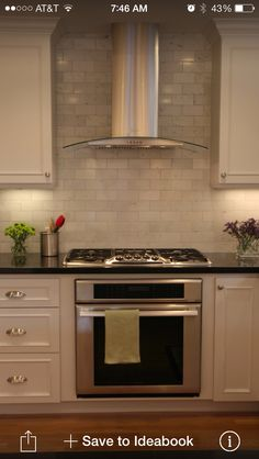 Tile all the way up around range. Hood like this. Tratto hood by Faber