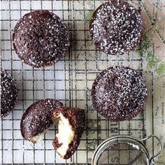 Chocolate Macaroon Cupcakes Recipe -A delightful coconut and ricotta cheese filling is hidden inside these chocolate cupcakes. —Dolores Skrout, Summerhill, Pennsylvania