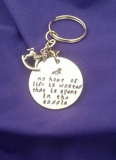 Hand stamped disc reads No hour of life is wasted that is spent in the saddle Rocking horse charm attached to chain Lightweight aluminium, thickness Key Chain, Equestrian, My Etsy Shop, Horse, Lovers, Personalized Items, Unique Jewelry, Handmade Gifts, Check