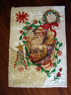 I ❤ embroidery & crazy quilting . . . Julia's beautiful postcard with Santa who seems to be looking through my holly decorated window, to see if I've been good enough to receive presents. Holding the card in hand, it really does look like a window and I love it.