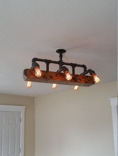 wood beam light chandelier industrial pipe by RuralIndustrial