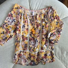 Yellow Gold Flowy Floral Blouse This top has only been worn a couple of times. I'm a petite, and it was simply a touch too big. I think it would fit a small best. It's in lovely shape, and super low maintenance to wash. ;) Xhilaration Tops Blouses