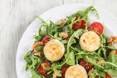 A delicious goats cheese salad with browned, creamy goats cheese and peppery leaves.