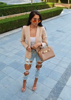Ripped jeans, white tank top, beige blazer, heels and bag. Classy, yet edgy.