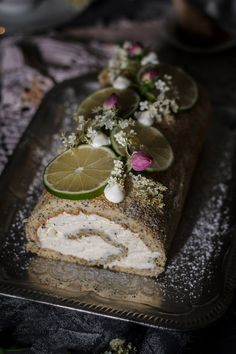 Lime Poppy Seed Elderflower Cake Roll. This poppy seed elderflower cake roll is a delicately light spring tea-time treat. Lime poppy seed sponge with elderflower mascarpone cream. Click to find the whole recipe or pin and save for later! | www.useyournoodles.eu