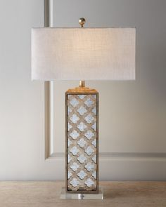 "#ONLYATNM Only Here. Only Ours. Exclusively for You. Oversized table lamp. Base is handcrafted of capiz shell, mirrors, and crystal. Silk hardback shade. Three-way switch; uses one 100-watt bulb. 18""W"
