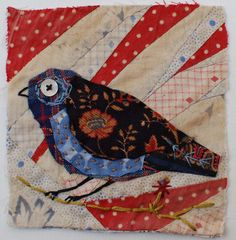Unframed appliqued bird with embroidery on to vintage crazy quilt scrap via Etsy