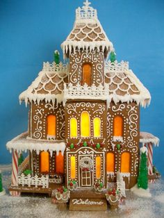 Gingerbread mansion ~ decorated with royal icing fences and rock candy trees! Windows made of melted butterscotch candies. Now THIS is a gingerbread house I could love. Gingerbread House Pictures, Gingerbread House Template, Cool Gingerbread Houses, Gingerbread Village, Christmas Gingerbread House, Gingerbread Cookies, Christmas Cookies, Christmas Houses, Gingerbread Men