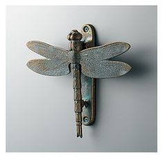 dragonfly...wouldn't these make interesting door pulls in the kitchen!
