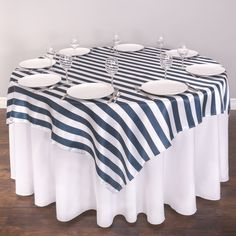 Jazz up plain white tablecloths with our bold 72 in. Square Navy Blue & White Striped Satin Overlays, featuring alternating 1 ½ in. wide navy blue and white stripes. This satin table topper is best suited for 4 ft. and 5 ft. round tables, and paired with draping tablecloths underneath. Blue & White Striped Overlays are perfect for nautical or coastal- themed weddings or parties. In addition, bold blue striped table toppers, void of all femininity, but big on panache, are fitting for boys or…