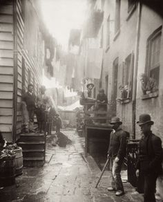 "Bandit's Roost (1888), by Jacob Riis, from ""How the Other Half Lives."" Bandit's Roost, at 59½ Mulberry Street (Mulberry Bend)"