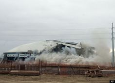See a building implosion (Texas Stadium - April 2010)